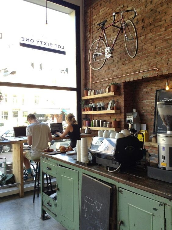 lot sixty one coffee roasters - like the green bar cabinets against the exposed brick wall ; rustic ; industrial ; vintage ; kitchen