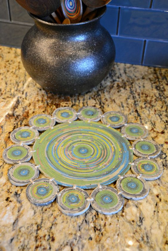 The Round Recycled Newspaper Trivet is a welcome item in the kitchen, serving as a reminder that we all can make a difference through recycling.  Our hot mat is beautifully handmade by Fair Trade Artisans who reuse earth's resources with recycled newspaper.  Handcrafted by artisans from Women's Cooperative in Baguio City, Philippines using an innovative process, the women turn old newspapers into new products by wrapping the paper into coils and forming them into spiraled building blocks.