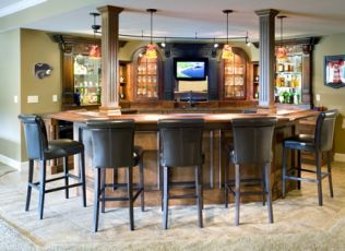 No better place to enjoy the big game with your friends than the custom built bar in this lower level remodeling project from CHC Creative Remodeling.