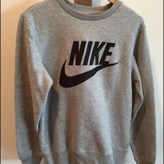 Nike sweatshirt Nike vintage swoosh pull over sweater. It's like new condition, only used once. Not sure if it's mens small but fits like a women's medium maybe large? Nike Sweaters Crew & Scoop Necks