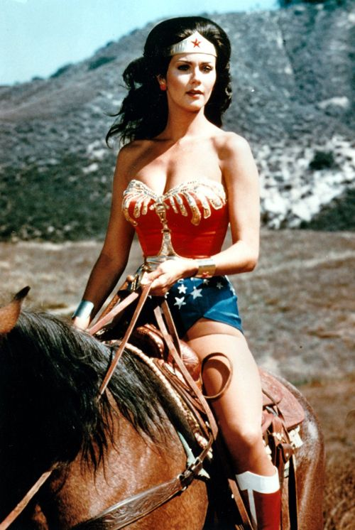 Lynda Carter as Wonder Woman riding a horse