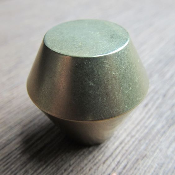 "The Turin decorative cabinet knob for either cabinet doors or drawers is supplied with a machine screw for through-bolting. It measures 1-1/4"" in diameter.  Also available in 1 1/2"", 1"", and 3/4""   Finishes available: Polished brass, Polished Bronze, Polished stainless steel, Satin stainless steel."