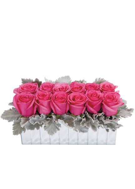 Alternative Dozen Rose Valentine's Day Arrangement: Bright pink super-sized roses surrounded by soft gray dusty miller, in a mirrored vase. —Florists' Review. Mirror Strips Vase, JamaliGarden.com: