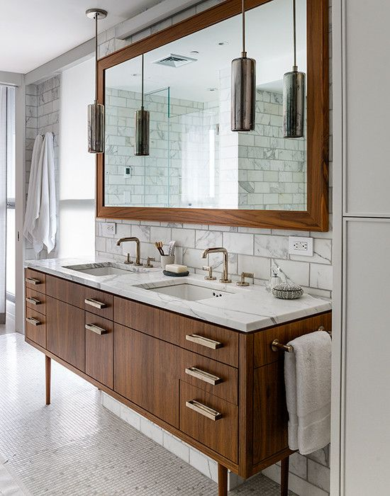 Vintage bathroom features mid-century modern washstand topped with white and grey marble
