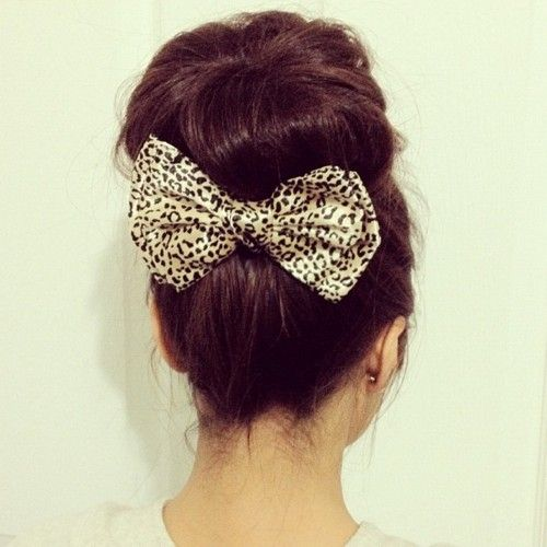 Hair, bow, sock bun.