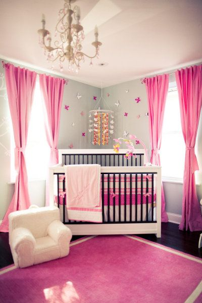 Baby Girl Room - cute and simple!  Love the splash of color, chandelier, hanging mobile, and love the flowers on the wall.