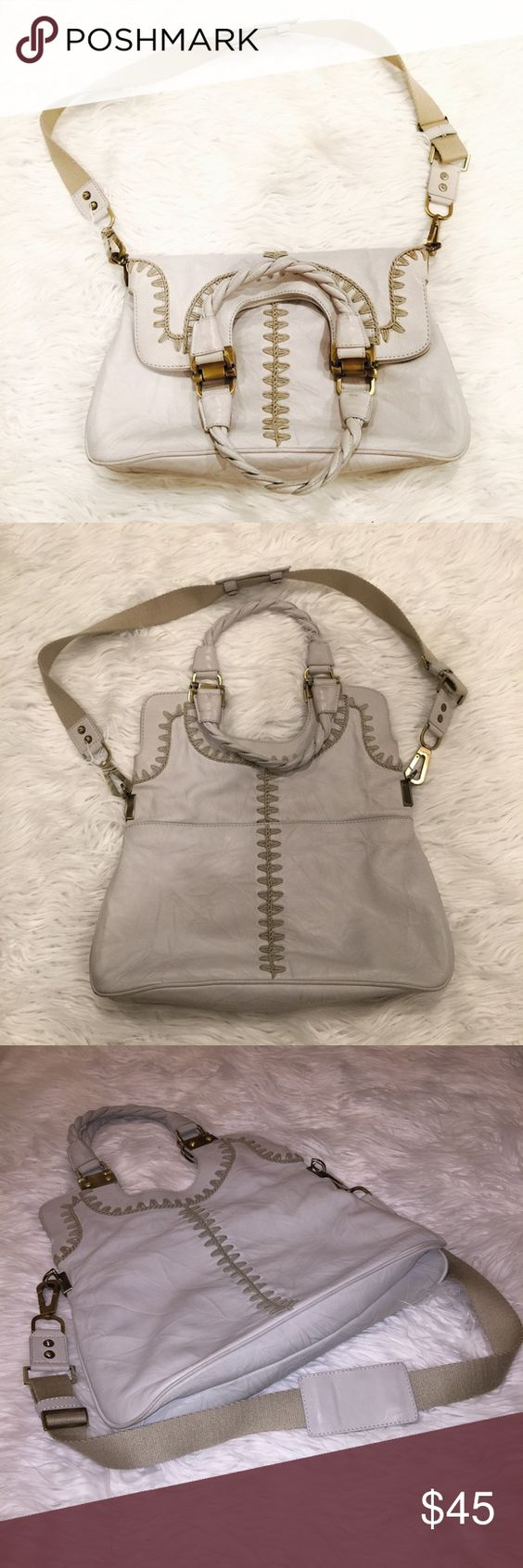 ✨Big Satchel✨ Worn many times. Kind of biege/gray. This bag has a few stains here and there, as well as some fading in the hardware. The leather has no rips of tears, just stains. I've never tried to clean this bag. There are many compartments and can be worn in a variety of ways. It's a little heavy due to the hardware, but it's so sturdy and has lasted me a long time. The strap is detachable. rafe Bags Satchels