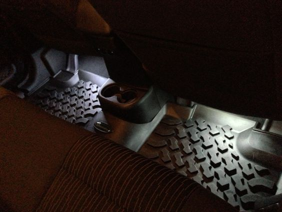 LED floor lights for your Jeep JK. Jeeps are awesome but lack some of the simple necessities of regular cars and SUVs. $13 at the auto parts store for 6in LED strips and you have foot well lighting for your Jeep. All you need to to is stick the self adhesive lights to the bare metal under the dash and under the seats in back...then tie them all into your dome lights and your done. Takes less than an hour...run all the wiring under you carpet, moulding and roll bar pads and it looks OEM.