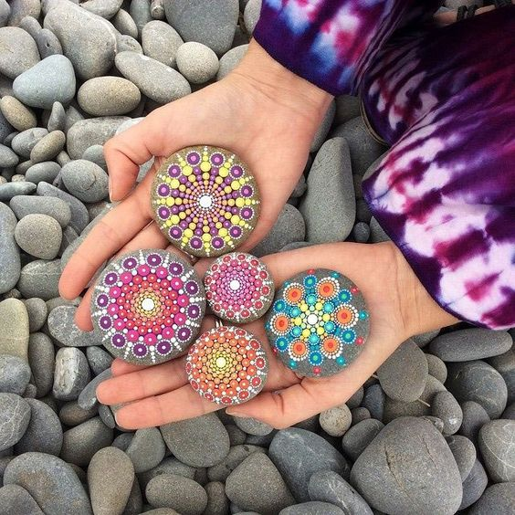Artist Finds Beautiful Beach Stones and Covers Them in Tiny Dots of Paint