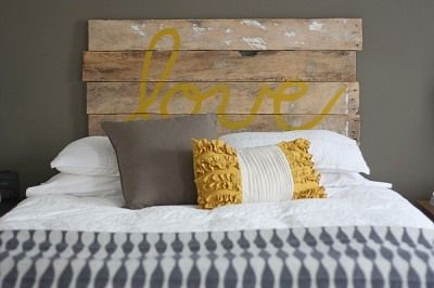 Unique headboard made from recycled fence slats...