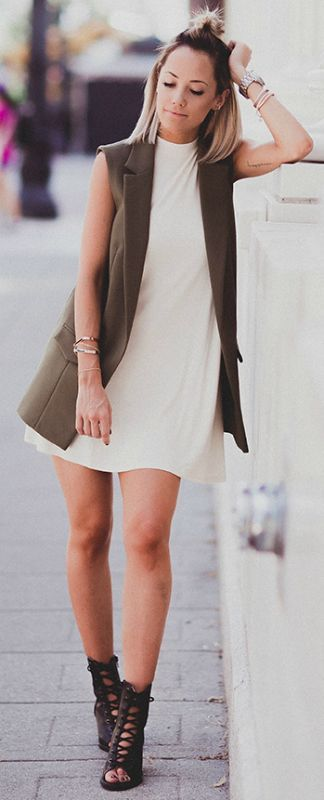 Sleeveless vest trend + stylish + pair of strappy gladiator-style sandals + Megan Anderson + edgy and alternative + cute khaki outfit Dress/Vest: TopShop, Shoes: Forever 21, Bag: Chanel.: