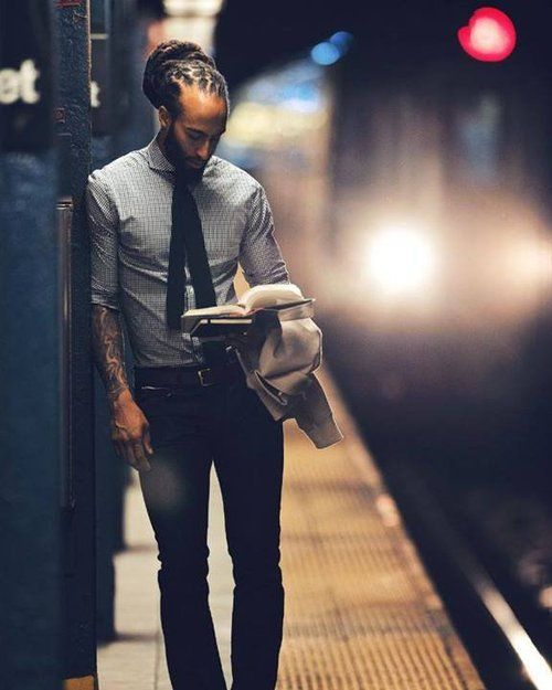 Black Men Are Beautiful. I don't know who this brother is but his attire, his skinny tie, he's reading, and his beautiful dreads. God is good.
