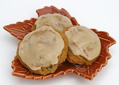 Pumpkin Cookies with Maple Icing    2 3/4 cups all purpose flour  1 teaspoon baking powder  1 teaspoon baking soda  1 teaspoon salt  1 1/2 teaspoons ground cinnamon  1 1/4 teaspoons ground ginger  3/4 teaspoon ground nutmeg (use slightly less if fresh ground)  3/4 cup (1 1/2 sticks) unsalted butter, slightly softened  2 cups packed light brown sugar  2 eggs  15 oz can of pumpkin (1 1/2 cups)  1 teaspoon vanilla  1/2 cup raisins (optional, but delicious)    ~Directions~  1.  Whisk together…