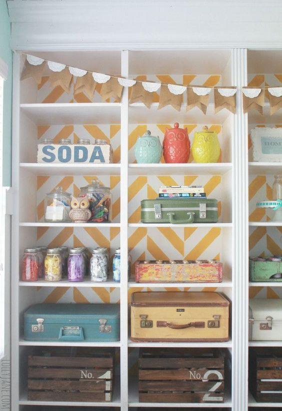 Herringbone Bookcase Craft Room Makeover using vintage suitcases, mason jars, crates and jars.