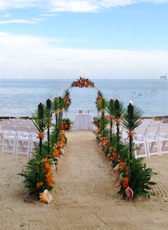 Tropical Beach Wedding Key West Wedding Flowers Ceremony Arch Tiki Torches Casa Marina