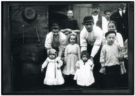 Miner's Families in Front of Barracks