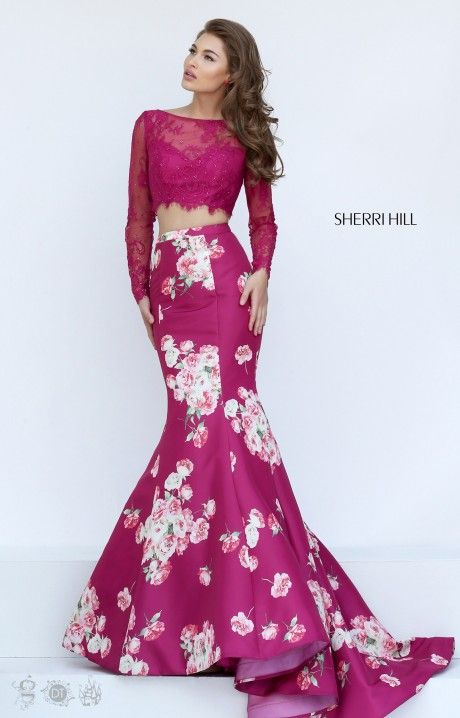 Be a sight for sore eyes in this floral Sherri Hill 50488. This fun two-piece gown has long sleeved lace top with a fitted mermaid bottom with a train.