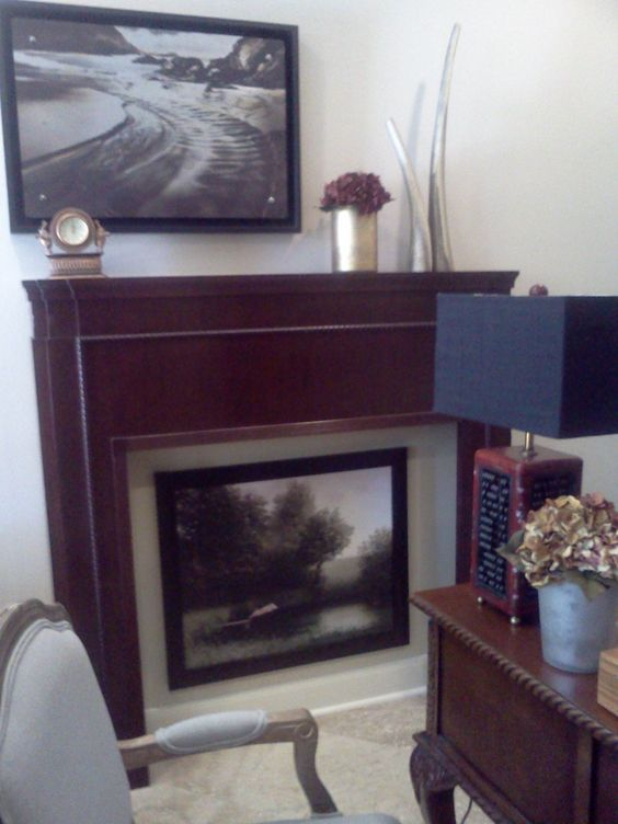 Tom's office redesign. The only existing item was his desk. My fav thing is the antique mantle front I found to add dimension and the serious, traditional artwork with the unexpected whimsical pig diving into the water.