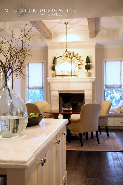 beck design blog...love the fireplace in the kitchen dining area and the built in benches by the windows...also love how open & airy it is
