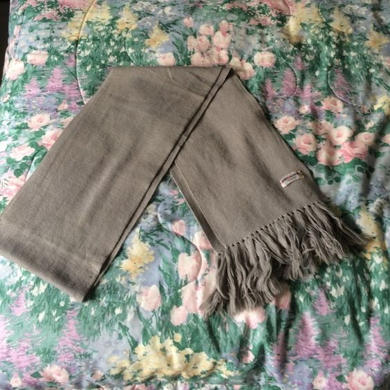 Saint Laurent vintage grey scarf Super long and luxurious saint Laurent scarf! In good condition, but please note the staining and thread Knicks as pictured. Yves Saint Laurent Accessories Scarves & Wraps