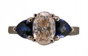 Lovely estate oval diamond, ceylon, sapphire and platinum ring! We love #PlatinumJewelry!