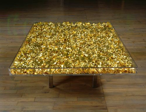 this could be made by gold leafing an old table, add a few coats of poly to protect it, or how about a mix of gold and silver leafing.   fromby Yves Klein