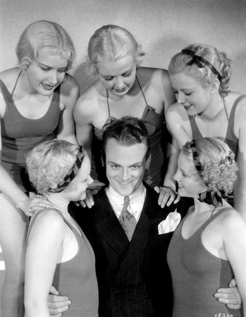 James Cagney surrounded by a bevy of beautiful chorus girls in 1933.