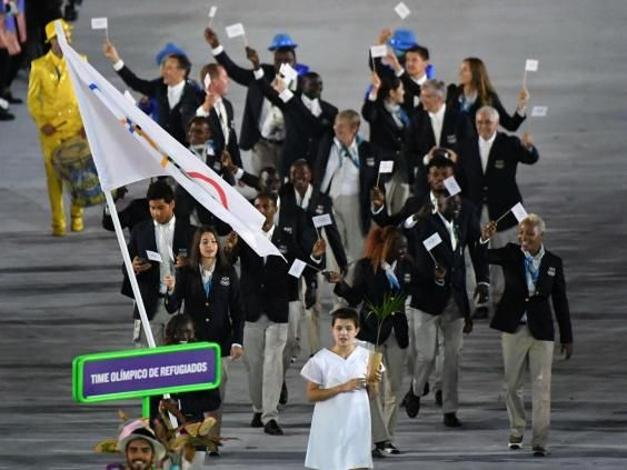 """For the first time in Olympic history, a refugee team is competing. The ten athletes, who are competing in events from judo to marathon running, are serving as a """"symbol of hope"""" for refugees. The inclusion of the team at the 2016 Rio Games reflects the steadily growing refugee crisis and shines a light on the plight of millions of displaced people displaced by war and conflict across the world."""