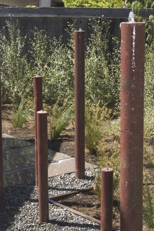 raw steel pipes - water feature love it sitting in the rocks