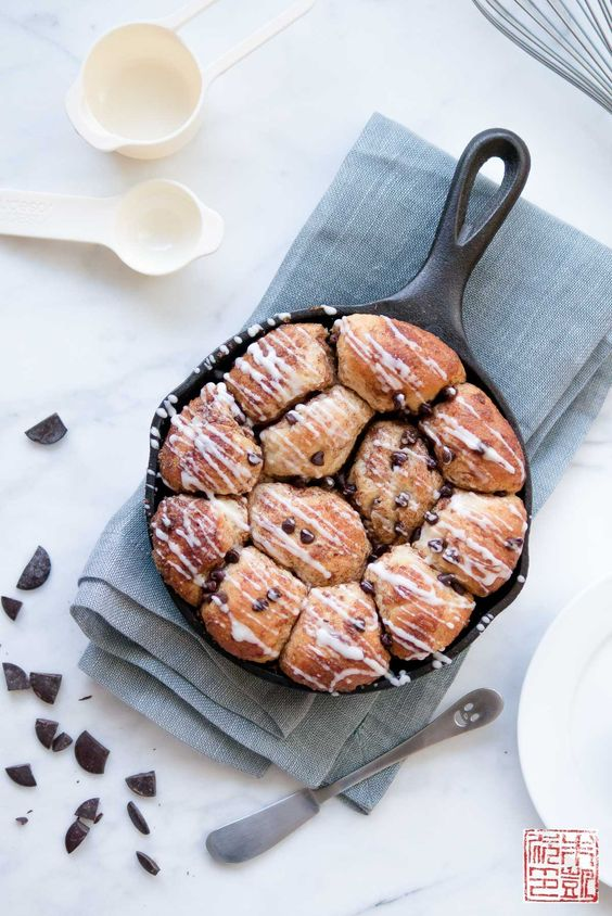 Cinnamon Chocolate Monkey Bread made with King Arthur Flour's White Whole Wheat Flour. Filled with chocolate chunks and drizzled with vanilla glaze.