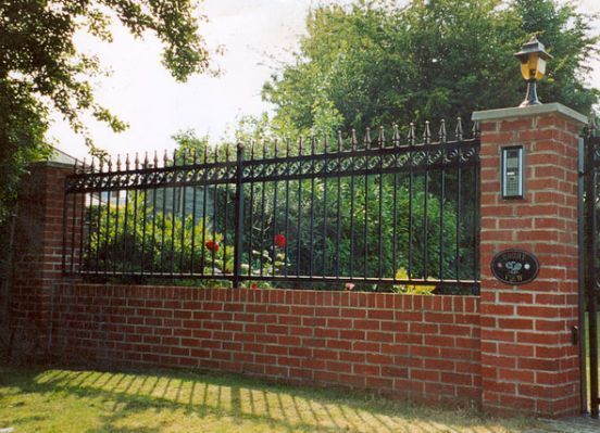 Wrought Iron Fence On Brick Wall Brick Wall Gardens Wrought