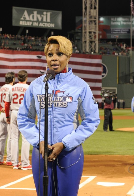 "Mary J. Blige focuses on delivering a soaring performance of ""The Star-Spangled Banner"" prior to game one of the World Series between the St. Louis Cardinals and Boston Red Sox on Oct. 23 in Boston"
