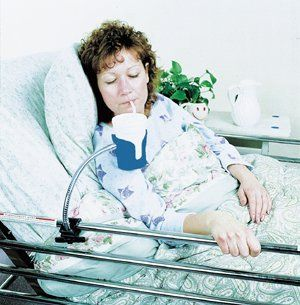 Bedside Beverage Holder by Aids to Daily Living. $36.99. Clamps onto any tubular bed frame, wheelchair frame, or other tubular frame with a diameter of 3/4 to 1¨ (1.9 to 2.5 cm).  Most glasses or cups will fit into the plastic holder, even those with handles. It can also hold a beverage can or bottle. An 11¨ (28 cm) long flexible, chromeplated gooseneck makes positioning of the cup holder easy