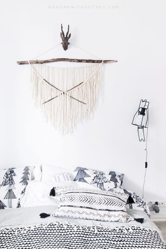 I am loving this wall hanging that I found on No Home Without You. It is made of just a branch and rope so it should be an easy DIY project!