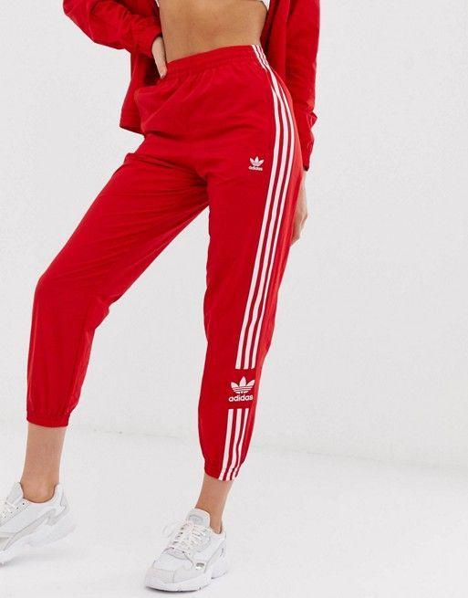 adidas Originals adicolor locked up logo track pants in red ...
