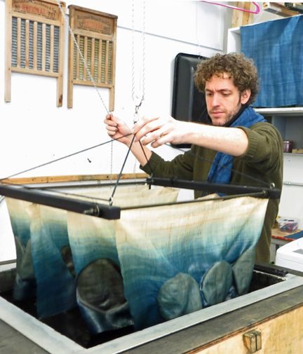 Rowland Ricketts dyeing cloth, The artist runsRicketts Indigoalong with his wife, Chinami, who is a weaver. Together they organically grow and process the indigo used to dye their textiles.