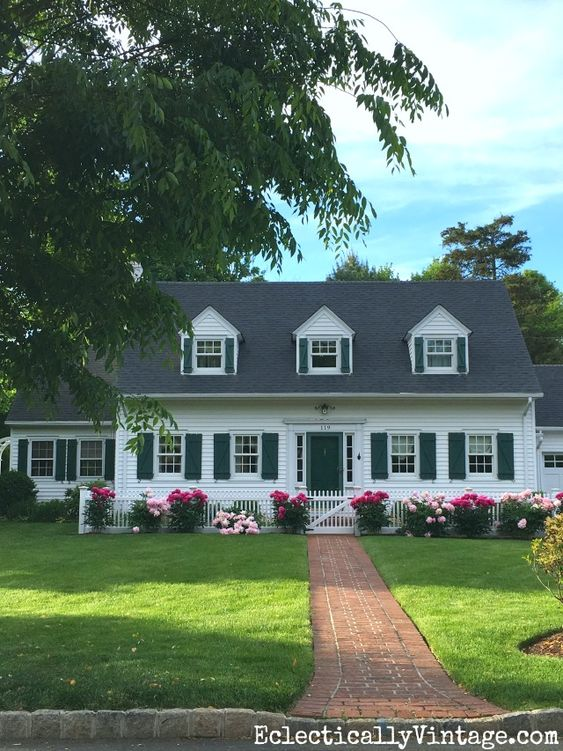 Love the row of peonies planted in front of this cape cod home eclecticallyvintage.com: