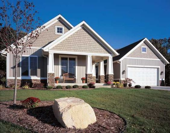 Colorful vinyl siding improving curb appeal of modern for Vertical siding on house
