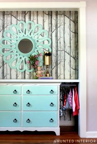 The Lion, Witch and the Wardrobe | Tree wallpaper in closet | aqua mirror and dresser with countertop over it.