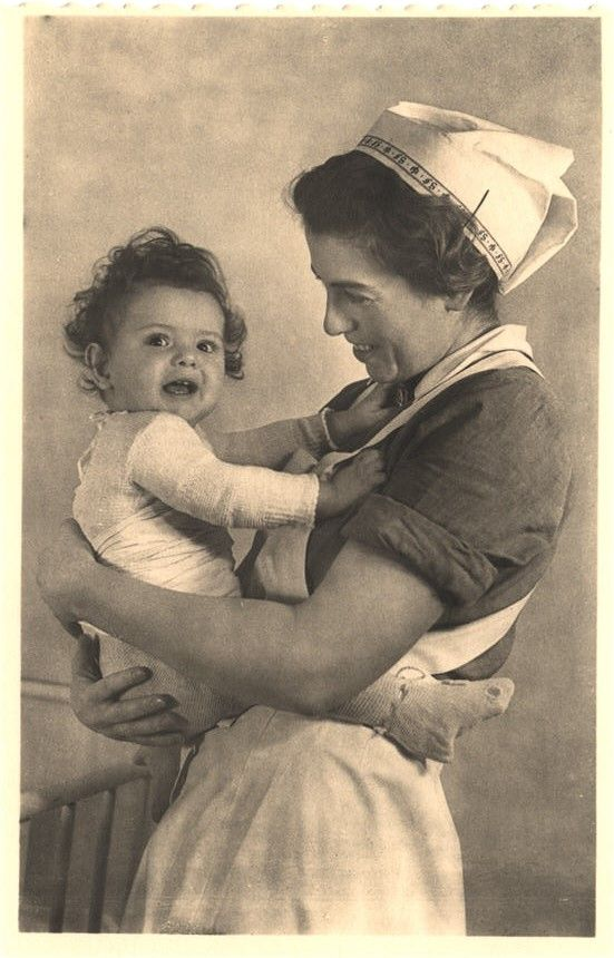 A portrait of a nurse holding a baby, 1930s. Pictures of Nursing: The Zwerdling Postcard Collection. National Library of Medicine
