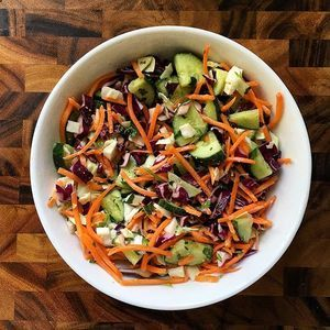 I need to share this with you before I wolf it down. Thai inspired salad: shredded carrots, white and red cabbage, and chopped cucumber. Dressing: I didn't measure anything out (doh! Next time)  but I used juice from 1 whole lime, sesame seed oil, rice vinegar and about 1 tbs smooth organic peanut butter. Blend dressing together then add in cilantro for the last 10 seconds. If you like it sweeter I bet you could add some honey. So so so good. #thaisalad #homemade #healthyfood
