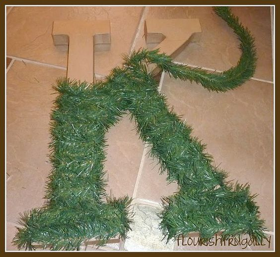 Hobby lobby letter wrapped in christmas tree garland add Christmas tree ribbon garland