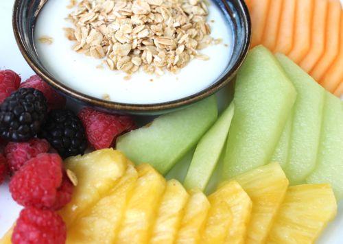 ::Mini delites from Mother's Day! Fresh fruit snacks (pineapple, cantaloupe, raspberries and blackberries, honeydew and yogurt with granola.) YUM!::
