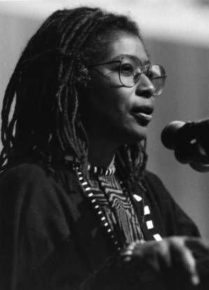 """""""Alice Walker does a reading of some of her new poetry at a homecoming to Eatonton, Ga."""" December 17, 1988 AJCP5376b, Atlanta Journal-Constitution Photographic Archives. Special Collections and Archives, Georgia State University Library."""