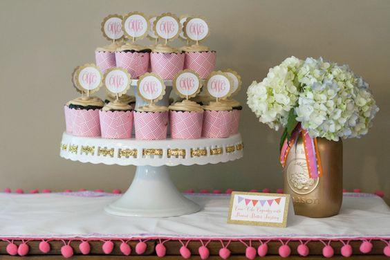Glam baby shower! Love the gold spray painted mason jar used as a vase.