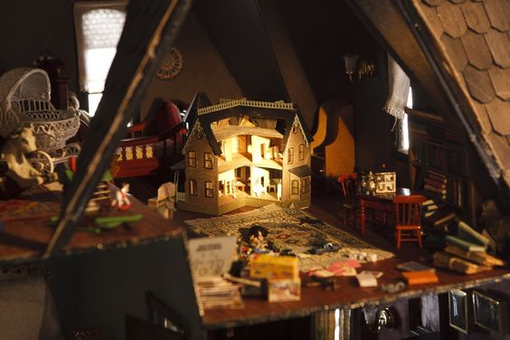 Peeking into the attic of Kroll's dollhouse feels almost like spying, it's so detailed. In a rather witty touch, the artist has even included a miniature replica of the dollhouse itself. Wow.