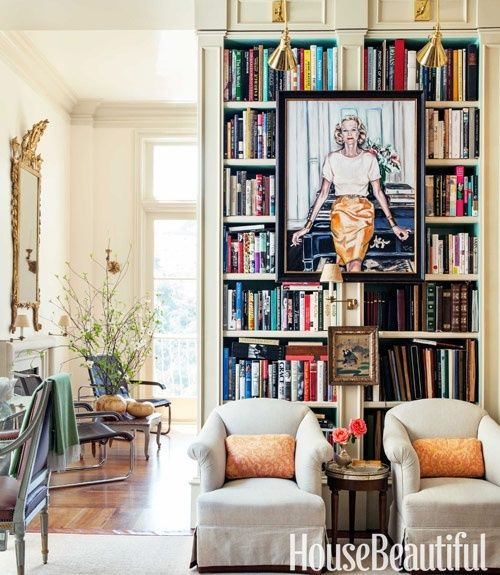 Love the art in front of the bookcase with lighting. fresh colors...
