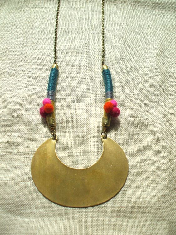 Bold Statement Necklace with a Large Brass Crescent, Hand Felted Wool Pom Poms, Color Wrapped Leather. $43.00, via Etsy.