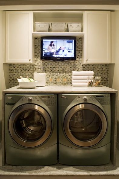 Laundry room with countertop folding space and flat screen tv