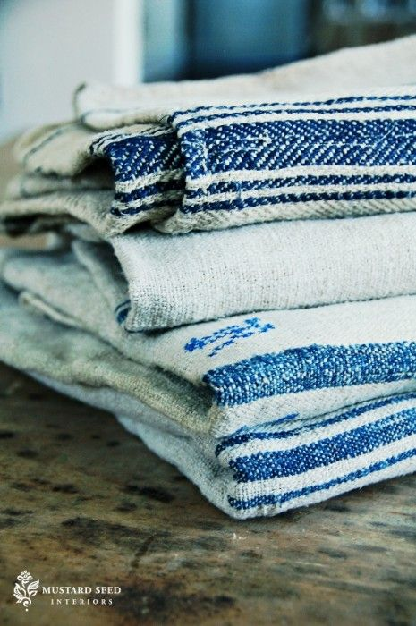 Grain sacks  If you love the look of grain sacks, but you just can't afford them, you can make very convincing replicas by painting stripes and initials on canvas drop cloths or nubby hemp fabric.
